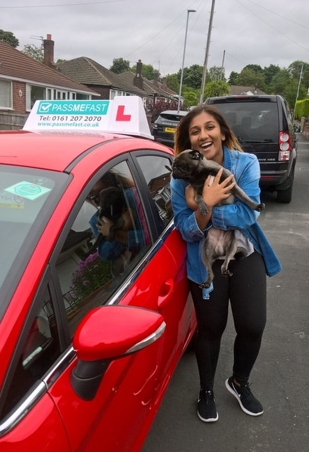 Jenna with her dog and the car in which she learned to drive