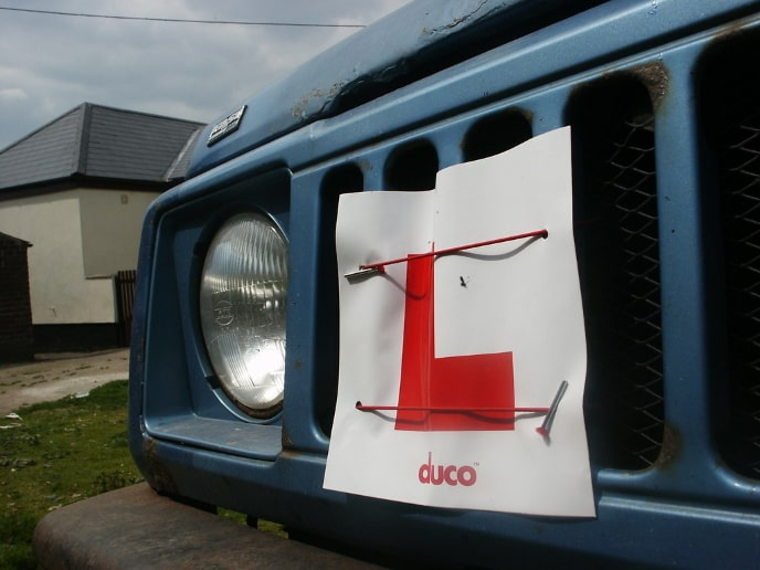 L plate attached to grill of a car