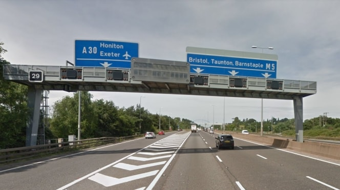 Signs on the M5 motorway near Exeter for the A30 and M5 roads