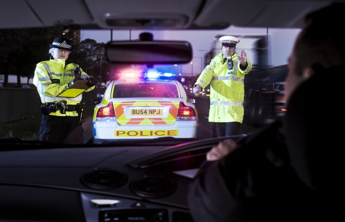 Male and female police officers pulling over car