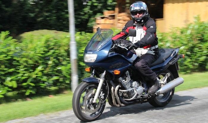 Man on motorbike smiling at camera