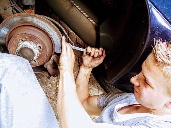 A mechanic repairing a car