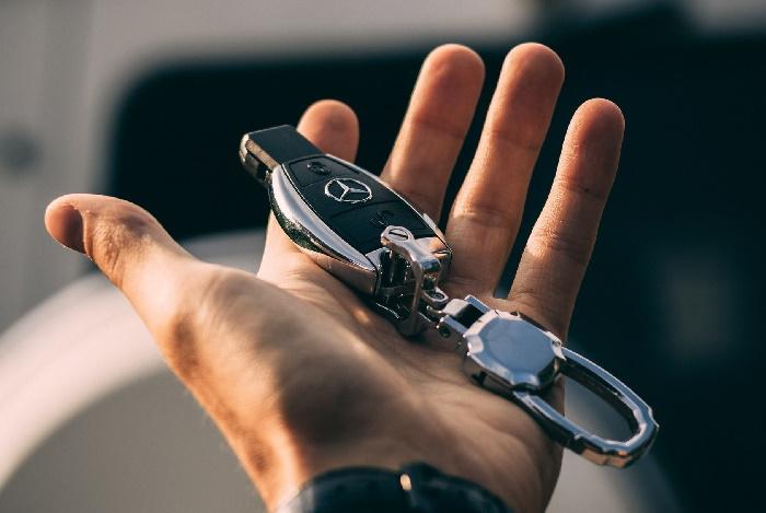 Hand holding Mercedes car keys