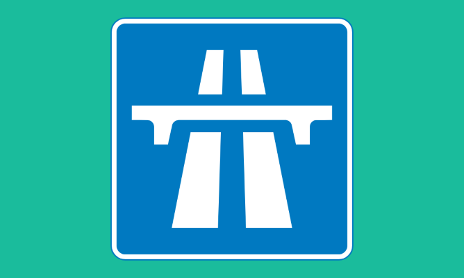 Motorway sign on green background