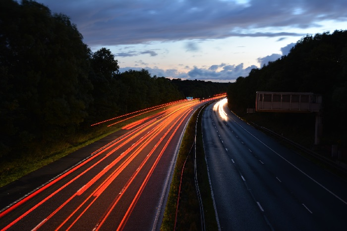 Motorway lanes at night with car lights