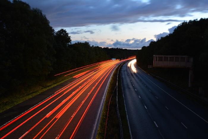 Motorway lanes at night with car lights