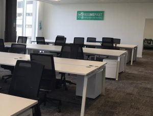 Empty desks and chairs in PassMeFast's brand new office