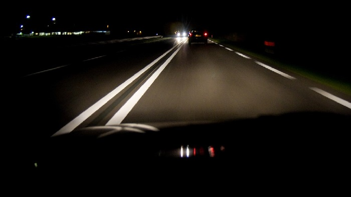 Dark road from perspective of car windscreen