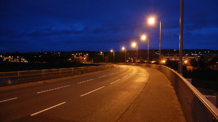 Road at night curving to the left