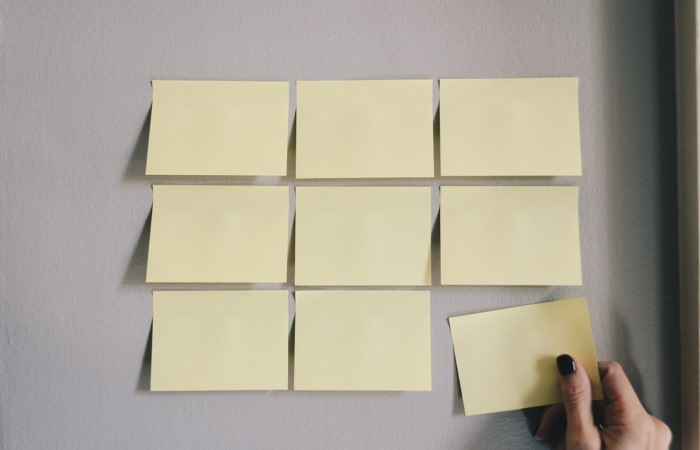 Nine blank sticky notes stuck to the wall