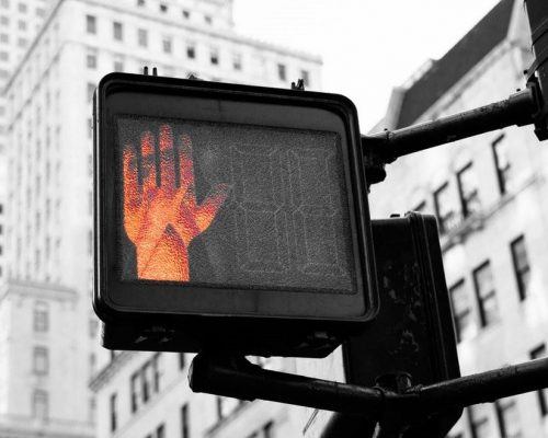 No walking red hand traffic signal