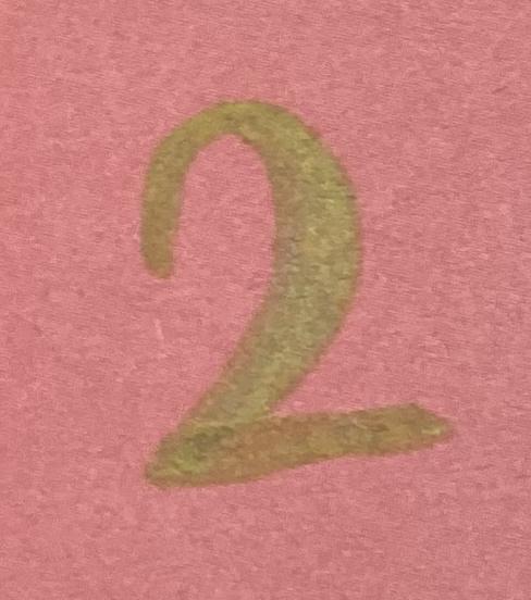 Gold number 2 on pink background