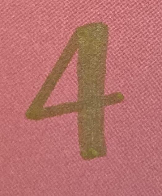 Gold number 4 on pink background