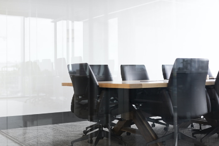 office conference table and chairs seen through glass wall
