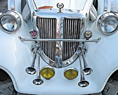 An old car with corns attached to its bonnet