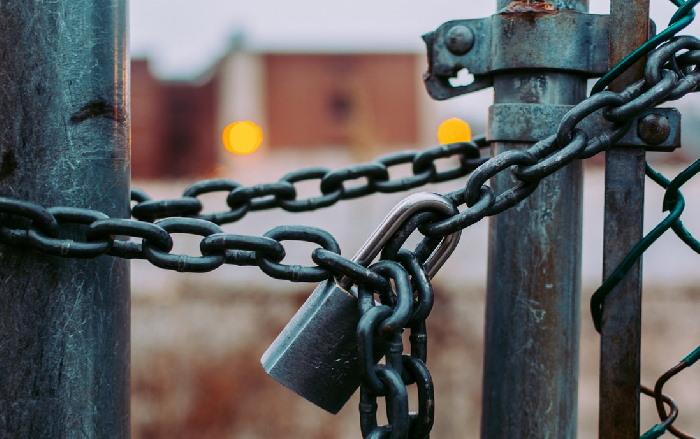 Padlock and chains locking gate
