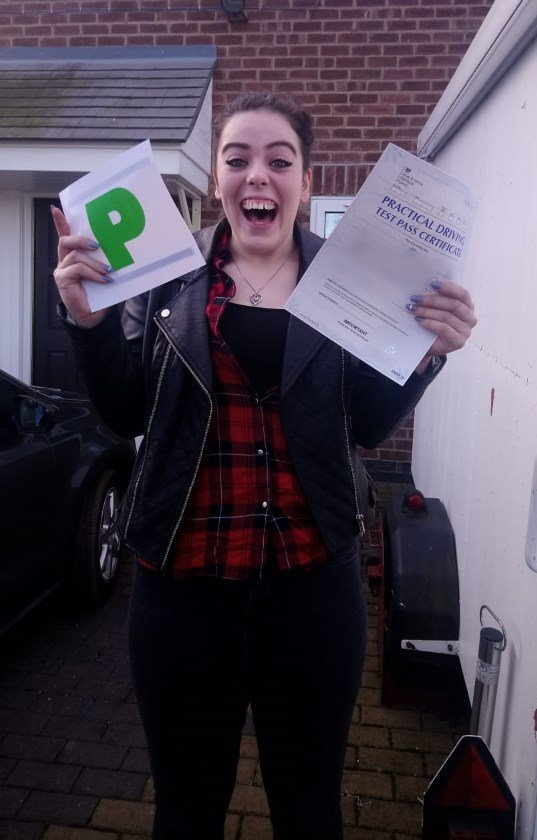 PassMeFast student holding certificate and P plates