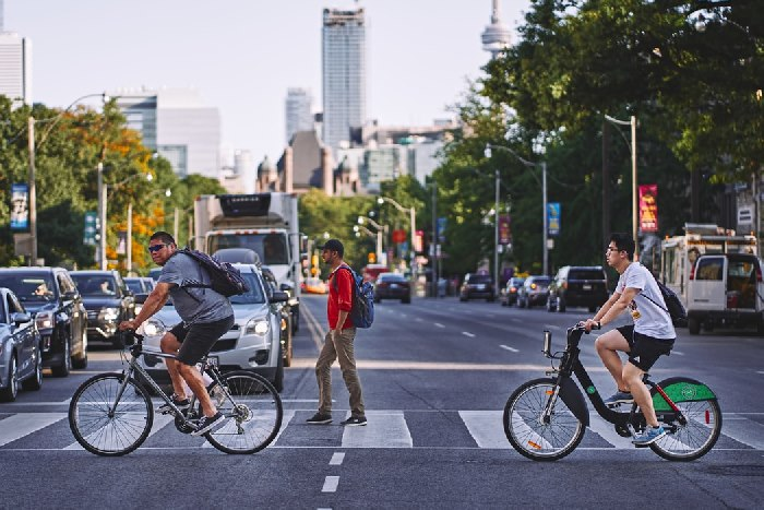 Cyclists and pedestrians crossing road