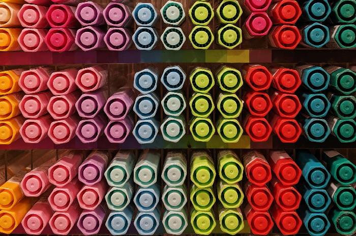 Multiple pens organised by colour