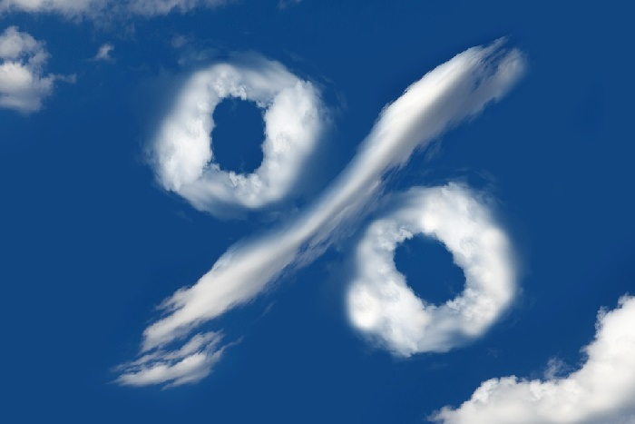 clouds forming percentage symbol on blue sky