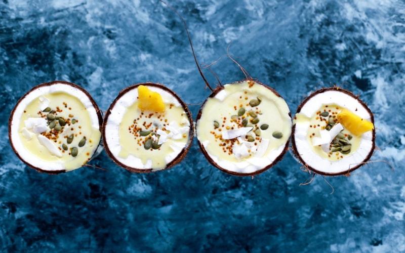 Piña coladas served in coconuts