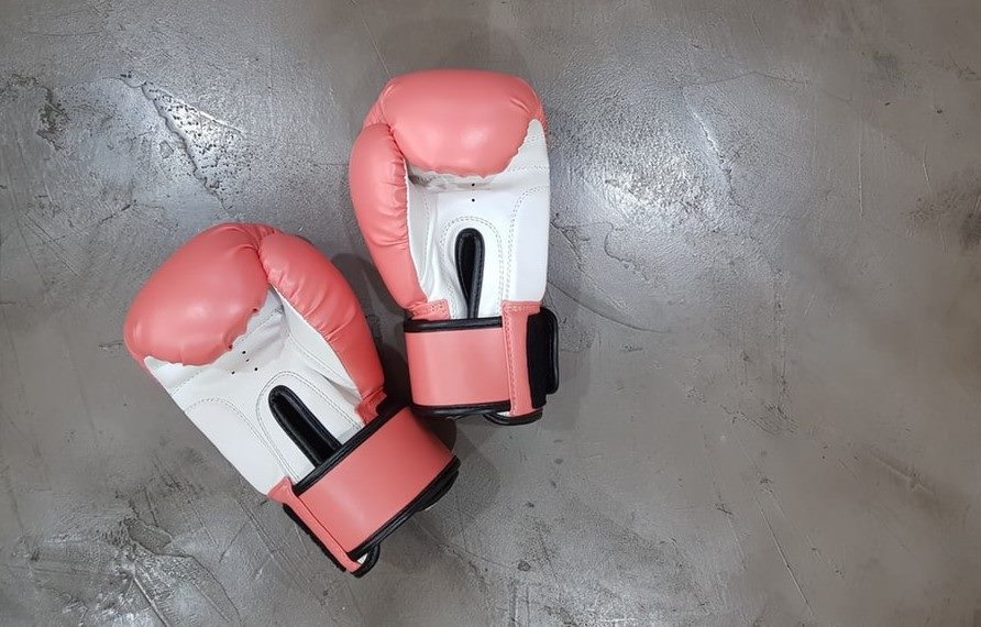 Pink boxing gloves on floor