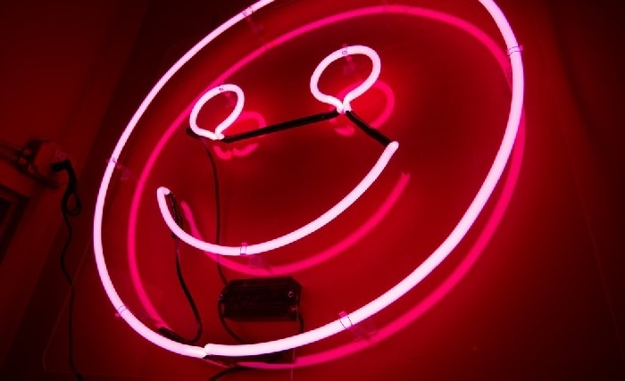 Pink neon sign of smiley face