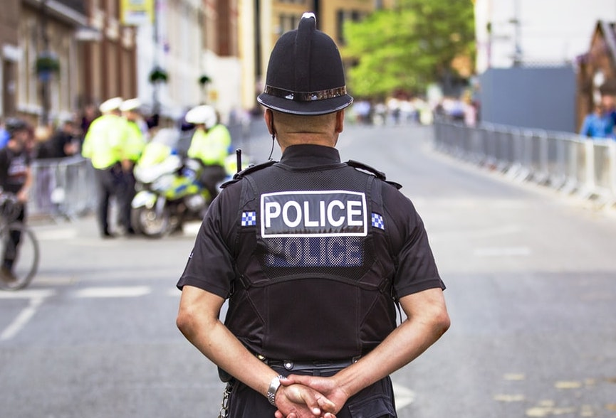 British police man with back turned