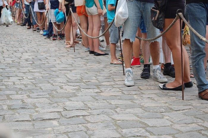 Feet of people in a queue