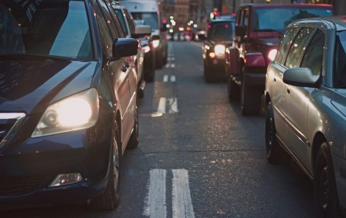 Queues of cars with their headlights on