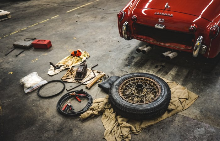 Red car and parts on the floor