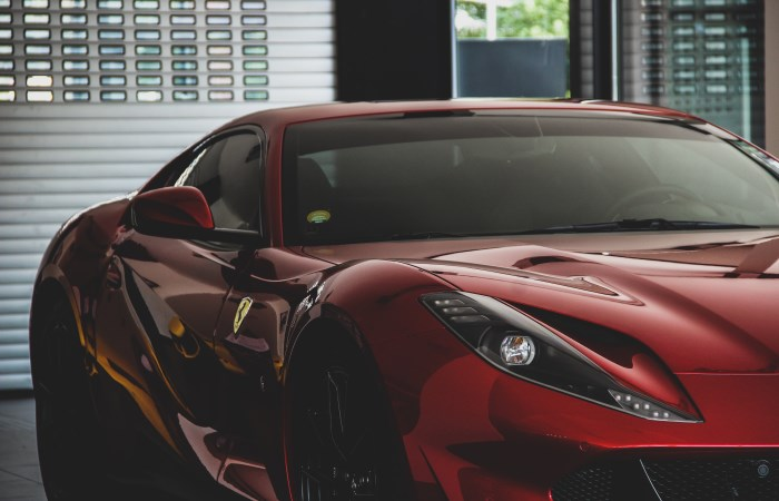 red sports car stored in garage