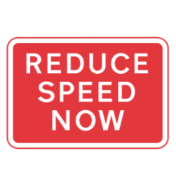 Reduce speed now road sign