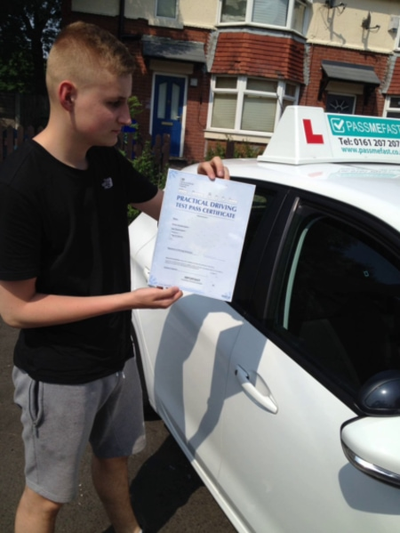 Rhys with his pass certificate and the car in which he learned to drive
