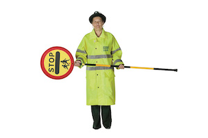 A lollipop lady holding her sign horizontally