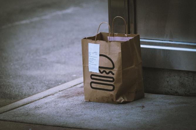 Shake Shack delivery bag on pavement