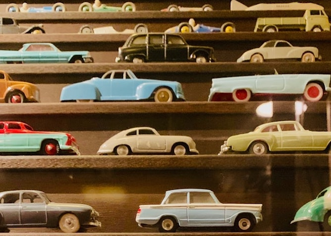 Shelves of different sized toy cars