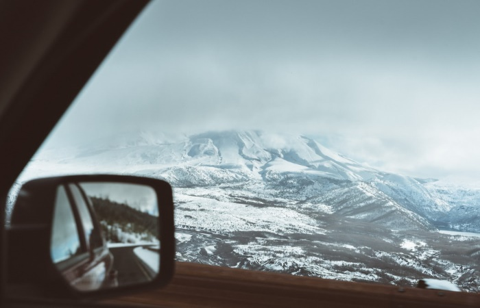 Shot of car side mirror and view of Mount Saint Helens