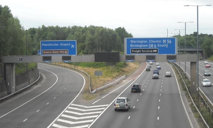 Signs by exit 5 of the M56 motorway