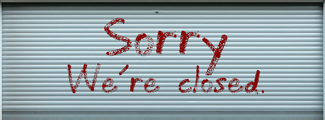 Door displaying the words 'sorry, we're closed'