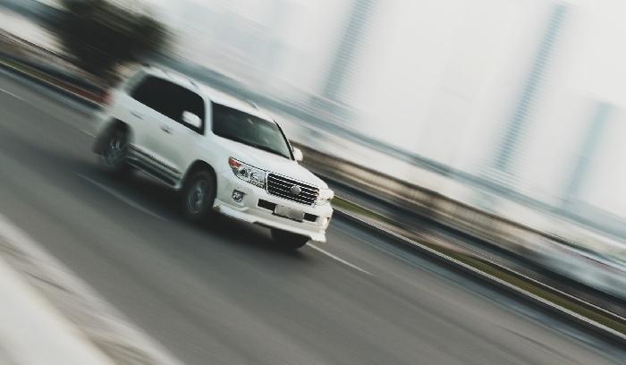 Speeding white car