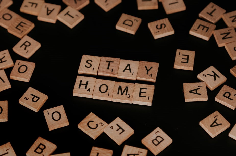 Scrabble letters spelling out 'stay home'