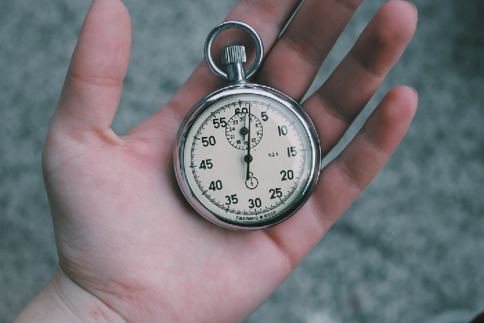 Silver stopwatch in hand