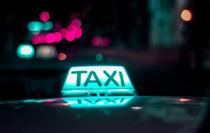 Taxi sign on car lit up