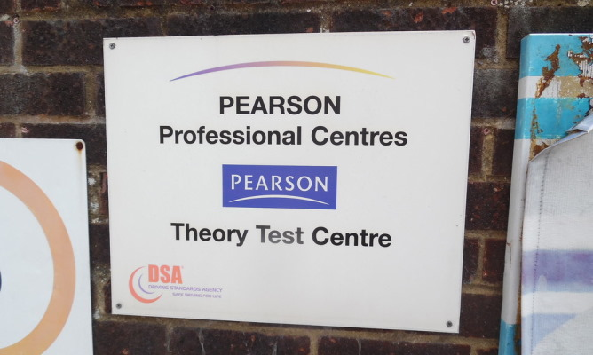 "Sign outside Slough theory test centre with the wording ""Pearson Professional Centres - Pearson Theory Test Centre"""