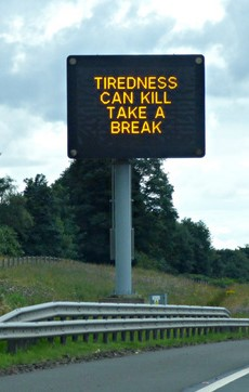 Tiredness can kill motorway sign