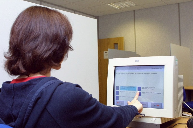 Candidate using a computer to complete the multiple choice section of the theory test