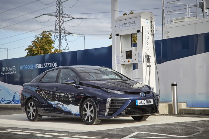 A Toyota Mirai hydrogen car at a filling station