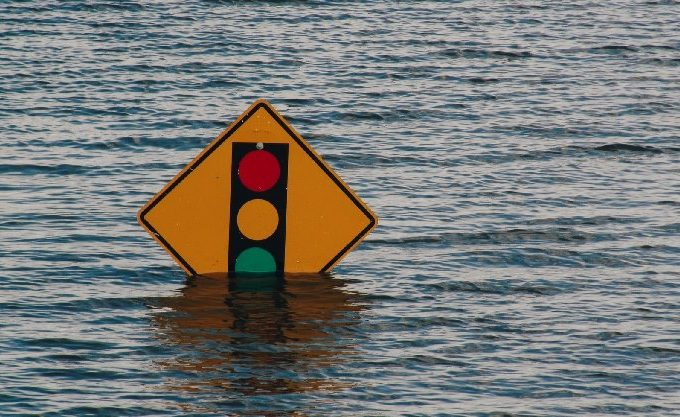 Traffic light sign submerged in body of water
