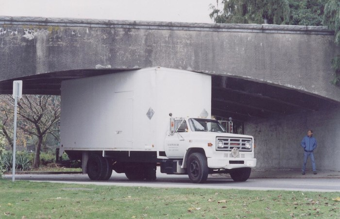 A lorry stuck under a bridge